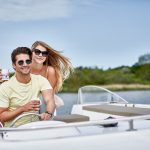 couple enjoying norfolk broads boating holiday