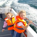 Children enjoying day boat hire on Norfolk Broads
